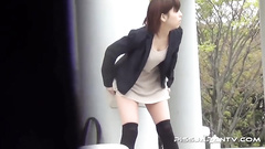 Sexy Asian doll was caught pissing in the street