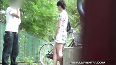 Pretty Asian girl pissing near the bikes