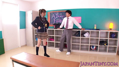 Japanese student chick pleases the guy with handjob