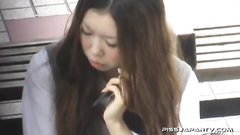 Asian girl sitting on the ground and masturbating