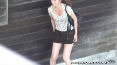 Japanese girl takes her white panty off in public