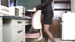 Horny Asian beauty pleasantly masturbates pussy in the office