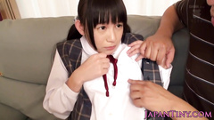 Japanese fucker is undressing cute chick to fuck her hard