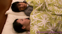 Cute Asian girl gently kisses her boyfriend and turns him on