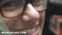 Wonderful Arab girl Mia Khalifa is excitingly undressing and posing in library